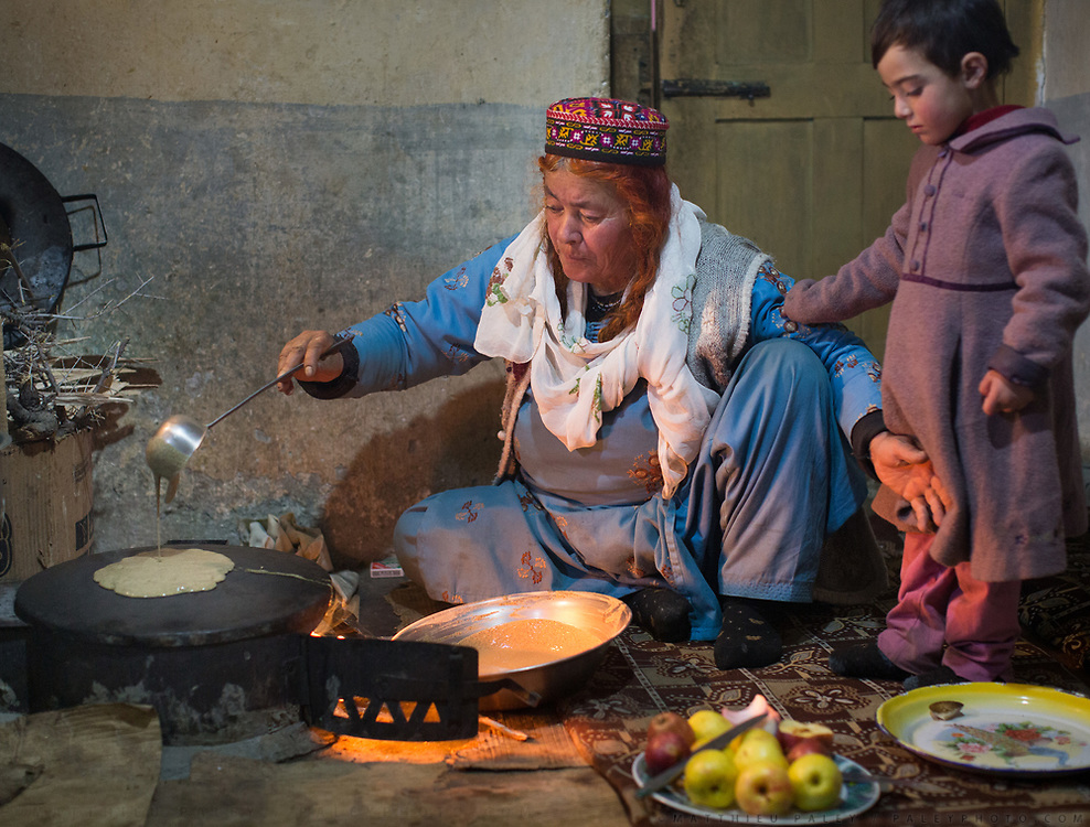 Cooking at Shahid Karim's house, making Barove Giyaling (Buckwheat Pancakes). In the village of Duikar, above Karimabad village, Hunza region.