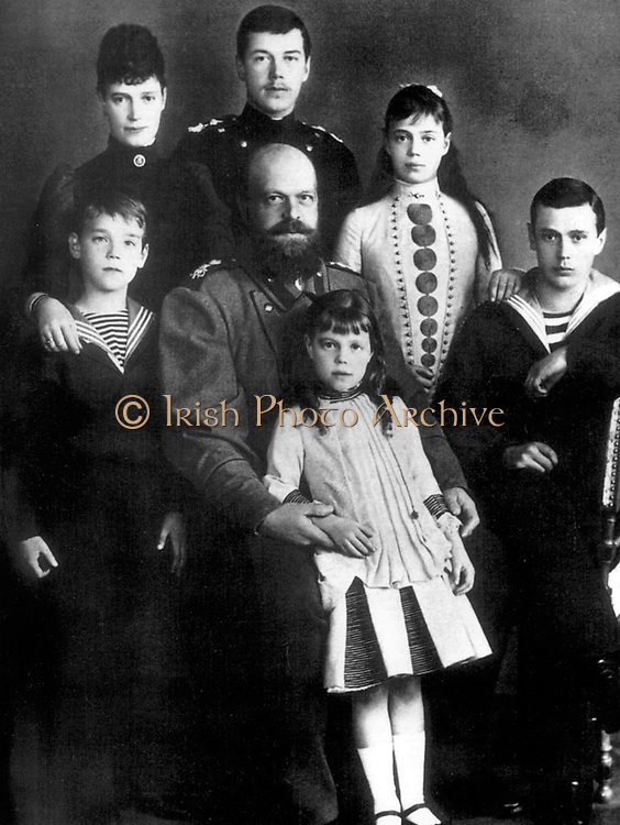 Tsar Alexander III and Empress Marie fedorovna of Russia with their children (Future Tsar Nicholas II is shown standing at the back iof the group. Circa 1885