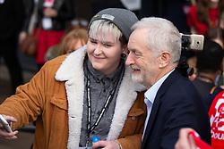 © Licensed to London News Pictures. 23/02/2019. Telford, UK. Labour leader Jeremy Corbyn poses for a selfie when arriving for the Labour Party Women's Conference in Telford. Photo credit: Dave Warren/LNP