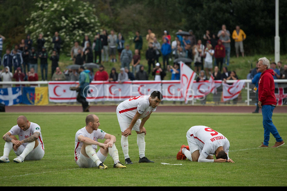 Northen Cyprus team mates after loosing 3-2 to Karpatalya  in penalties during the Conifa Paddy Power World Football Cup finals on the 9th June 2018 at Queen Elizabeth II Stadium in Enfield Town in the United Kingdom. Team mates from the Turkish Republic of Northern Cyprus  take on the Hungarians in Ukraine for the CONIFA World Football Cup final. CONIFA is an international football tournament organised by CONIFA, an umbrella association for states, minorities, stateless peoples and regions unaffiliated with FIFA. (photo by Sam Mellish / In Pictures via Getty Images)