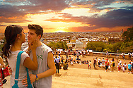 Young couple about to kiss on the steps of the Sacré-Coeur Basilica, Montmartre, Paris at sunset .<br /> <br /> Visit our FRANCE HISTORIC PLACES PHOTO COLLECTIONS for more photos to download or buy as wall art prints https://funkystock.photoshelter.com/gallery-collection/Pictures-Images-of-France-Photos-of-French-Historic-Landmark-Sites/C0000pDRcOaIqj8E