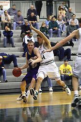30 December 2006: Jim Cash cuts hard against Jason Bloom. The Titans outscored the Britons by a score of 94-80. The Britons of Albion College visited the Illinois Wesleyan Titans at the Shirk Center in Bloomington Illinois.<br />