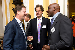 © Licensed to London News Pictures. 03/09/14. Admiralty House, Whitehall, London. Celebratory chefs Valentine Warner (middle) and Ainsley Harriott (right) were among the guests at the Deputy Prime Minister Nick Clegg's reception to celebrate the launch of the free school meals campaign. Photo credit : David Tett/LNP