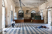 A building worker asleep on a break inside the derelict Hotel du Ville that has been saved by INTACH Indian National Trust for Art and Cultural Heritage. Pondicherry, India. Pondicherry now Puducherry is a Union Territory of India and was a French territory until 1954 legally on 16 August 1962. The French Quarter of the town retains a strong French influence in terms of architecture and culture.