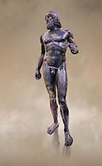 Full length view of the Riace bronze Greek statue A cast about 460 BC. statue A was probably sculpted by Myron. The style of the Riace statues straddles the archaic period and heralds the start of the classical period. Both statues depict strong young naked warriors who stand calmly but exuding great power. Museo Nazionale della Magna Grecia,  Reggio Calabria, Italy.  .<br /> <br /> If you prefer to buy from our ALAMY STOCK LIBRARY page at https://www.alamy.com/portfolio/paul-williams-funkystock/greco-roman-sculptures.html . Type -    Riace     - into LOWER SEARCH WITHIN GALLERY box - Refine search by adding a background colour,  etc.<br /> <br /> Visit our ROMAN WORLD PHOTO COLLECTIONS for more photos to download or buy as wall art prints https://funkystock.photoshelter.com/gallery-collection/The-Romans-Art-Artefacts-Antiquities-Historic-Sites-Pictures-Images/C0000r2uLJJo9_s0