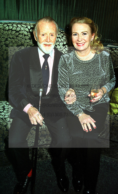 Actor SIR JOHN MILLS and his daughter JULIETTE MILLS, at a party in London on 20th December 1999.MZZ 18