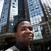 Robert Bolimo, 23, ( on the right )is a Nairobits graduate. He works as an intern at Jengo Web in down town Nairobi and he hopes to be able to stay on and  get a job at Jenga Web. Here he is below the tower block where he works on the top floor.  Robert came to Nairobi in 1992 and live alone in Mukuru slum. His family live 450 km out of Nairobi, Robert is their only hope for a better life and financial security..Nairobits is a charity teaching kids from Nairobi's slums IT and train them to get work in the IT sector.Every year 1mill young people graduate and leave school and only 1/3 have any hope of getting a job. Nairobits aim to train more than 500 young people / year from the slums, some with only basic formal education, how to set up their own business or get a job in the growing IT sector in Kenya.