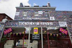 "© licensed to London News Pictures. London, UK 06/08/2012. The House of Reeves furniture store which was burnt down in last year's riots has been rebuilt and ready to be launched again on 08/08/12. The shop has been covered in 4000 images of young people with positive messages on August 6, 2012 in Croydon. The youth volunteering charity ""vInspired"" are marking the one year anniversary of the riots in Croydon by displaying thousands of images of young Britons holding up positive messages about themselves on the House of Reeves furniture store which was destroyed in last year's violence. Photo credit: Tolga Akmen/LNP"