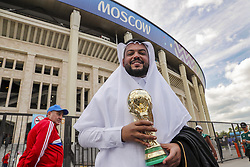 fan of Saudi Arabia with the World Cup in the front of the Luzhniki Stadium during the 2018 FIFA World Cup Russia group A match between Russia and Saudi Arabia at the Luzhniki Stadium on June 14, 2018 in Moscow, Russia