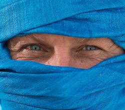 man with blue eyes with blue fabric