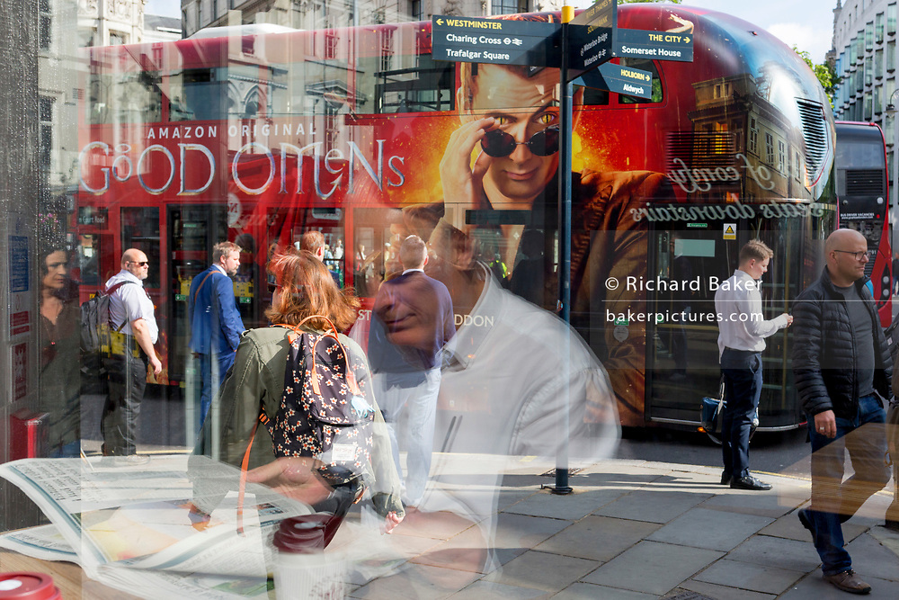 A businessman sits in the window of a Pret a Manger cafe during the morning rush-hour at the corner of  Waterloo Bridge and the Strand, on 5th June 2019, in London, England.