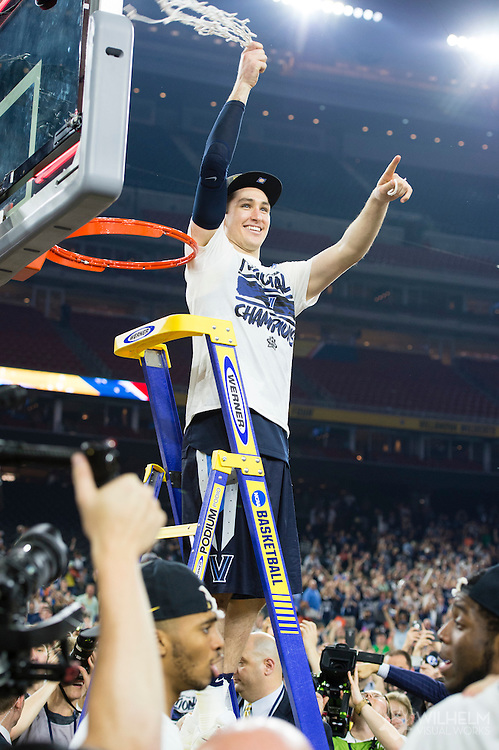 04 APR 2016: Guard Ryan Arcidiacono (15) of Villanova University cuts down the net after their win against the University of North Carolina during the 2016 NCAA Men's Division I Basketball Final Four Championship game held at NRG Stadium in Houston, TX.Villanova defeated North Carolina 77-74 to win the national title. Brett Wilhelm/NCAA Photos