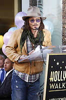 4/1/2011 Johnny Depp speaks to the audience at Penelope Cruz's Hollywood Walk of Fame ceremony