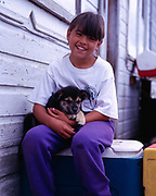 Daniel Hansen with puppy, village of Angoon, Admiralty Island, Alaska.<br /> Please note: Use of this photo requires a small extra model fee be paid to Daniel Hansen, the child in the photo. Please contact Fred Hirschmann for details. Thank you.