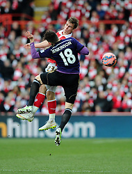 Bristol City's Joe Bryan battles for the high ball with West Ham's Carl Jenkinson  - Photo mandatory by-line: Joe Meredith/JMP - Mobile: 07966 386802 - 25/01/2015 - SPORT - Football - Bristol - Ashton Gate - Bristol City v West Ham United - FA Cup Fourth Round