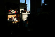 An African immigrant prepares a cup of tea in his dormitory at the Marsa Open Centre in Marsa in Valletta's Grand Harbour April 21, 2006..