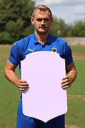AFC Wimbledon striker James Hanson (18) holding Fifa sign during the AFC Wimbledon 2018/19 official photocall at the Kings Sports Ground, New Malden, United Kingdom on 31 July 2018. Picture by Matthew Redman.