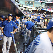 John Gibbons, Toronto Blue Jays Manager, in the dugout  as he watches Josh Donaldson head out to bat during the New York Mets Vs Toronto Blue Jays MLB regular season baseball game at Citi Field, Queens, New York. USA. 16th June 2015. Photo Tim Clayton