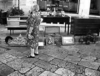A woman browses the market at Ostuni, Puglia, southern Italy