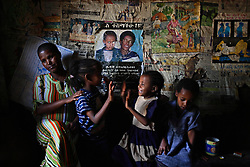 Public service announcements, warning against issues like AIDS and marriage by abduction, adorn the walls of Elsa Haile's home where she now works as a prostitute in Bahir Dar, Ethiopia on May 27, 2007.  At age 11, Elsa, 20, ran away from home the day she was supposed to get married to a neighboring villager. She was later offered a job in a restaurant, but it turned out to be a brothel. Elsa does not know who fathered her daughter and has yet decided to test herself or her child for HIV, but she hopes to someday escape from nightmare her life has become.