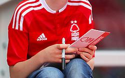 A Nottingham Forest fan waits for an autograph
