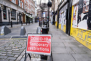 Covid-19 temporary restrictions sign in Soho as the national coronavirus lockdown three continues on 29th January 2021 in London, United Kingdom. Following the surge in cases over the Winter including a new UK variant of Covid-19, this nationwide lockdown advises all citizens to follow the message to stay at home, protect the NHS and save lives.