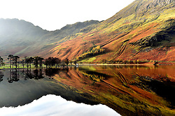 File photo dated 29/10/14 of autumn reflections are seen on Lake Buttermere in the Lake District in Cumbria, as the Lake District has been designated as a World Heritage Site, Unesco has said.