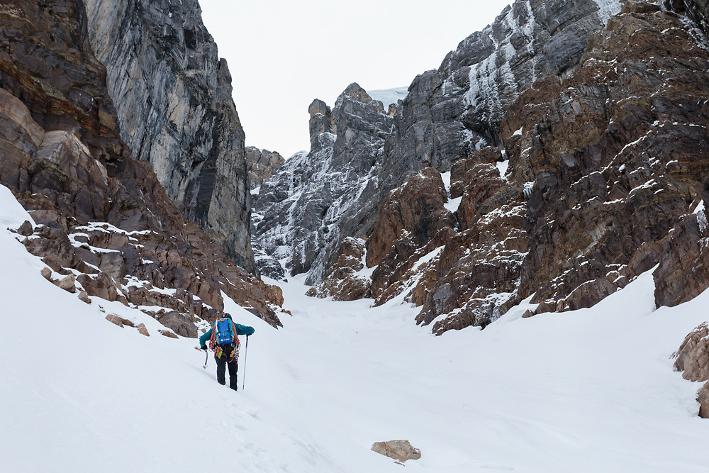 Pat Lindsay at the base of the north face of Mount Quadra in the Canadian Rockies