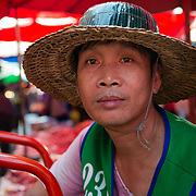 Portrait of a porter waiting for work at Khlong Toei market, Bangkok