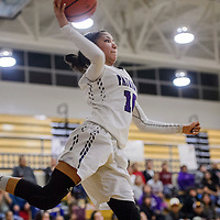 Miyamura Patriot Sarah Gilmore (10) leaps over the baseline to to throw the ball back to a teammate in a game against the Kirtland Central Broncos Friday at Miyamura High School.