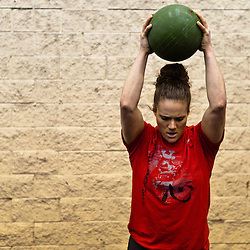 Quinn Megargel does a ball slam during a WOD. Crossfit image, picture, photo, photography of health, elite, exercise, training, workouts, WODs, taken at Progressive Fitness CrossFit,Colorado Springs, Colorado, USA.