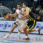 Efes Pilsen's Kerem TUNCERI (L) and Fenerbahce Ulker's Roko Leni UKIC (R) during their Turkish Basketball league derby match Efes Pilsen between Fenerbahce Ulker at the Sinan Erdem Arena in Istanbul Turkey on Sunday 24 April 2011. Photo by TURKPIX