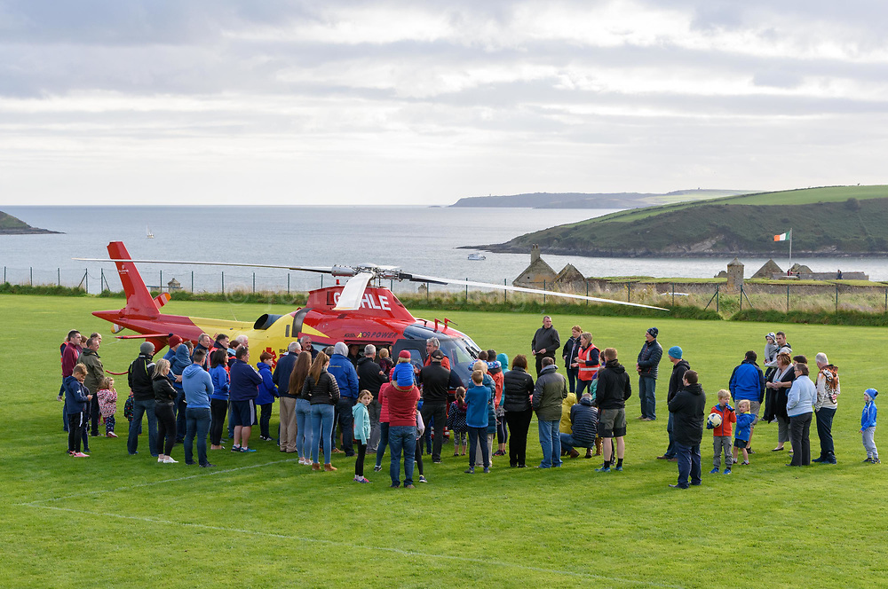 """REPRO FREE<br /> Crowds gathered as the Irish Community Rapid Response (ICRR) Air Ambulance visited Madden Park in Kinsale at the weekend. Based in North Cork the first community air ambulance in the country will serve Munster and South Leinster delivering critical medical interventions within """"the golden hour,"""" meaning the time period during which there is the highest likelihood that prompt medical treatment will prevent serious injury or death.<br /> Picture. John Allen"""