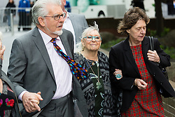 © Licensed to London News Pictures. 09/05/2014. London, UK. Artist and television personality, Rolf Harris arrives at Southwark Crown Court in London on 9th May 2014. Rolf Harris has been charged with 16 counts of indecent assault on teenage girls and of making indecent images of children.. Photo credit : Vickie Flores/LNP