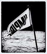 """Putney, Greater London, ENGLAND, 5th March 2006, Umpire's flag, hanging from the back of the umpires launch, at a Pre 2006 Boat Race Fixture running up to, """"The Annual Boat-race"""",    """"Film Noir Style Photography"""", © Peter SPURRIER,"""