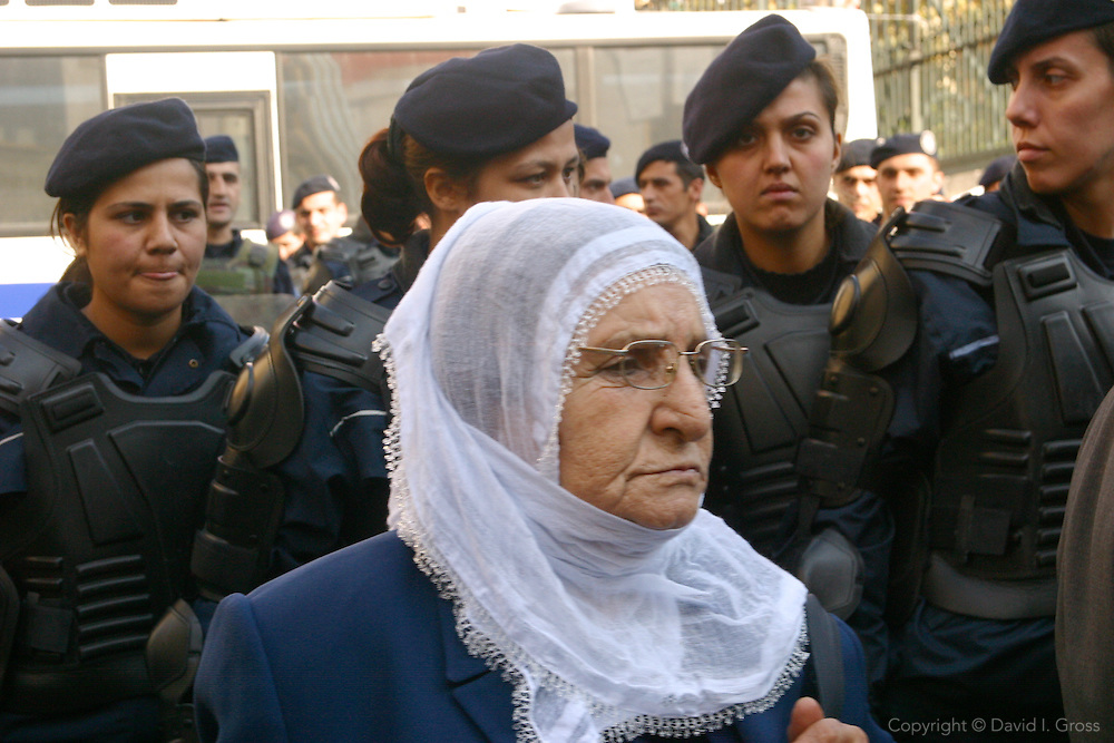 Kurdish mothers protest their sons' disappearances, and the government's silence, in the mostly Kurdish southeast of Turkey where the government has been fighting an insurgency for 20 years. The protesters appeared on the main street near Taksim in Istanbul, a major tourist area. The old women were arrested and taken away within two minutes of starting their protest.