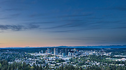 United States, Washington, Bellevue, downtown skyline with gCascade Mountains in distance at sunset (aerial)