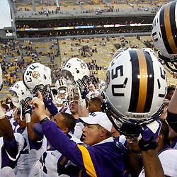 October 22, 2011; Baton Rouge, LA, USA; LSU Tigers head coach Les Miles  celebrates with his players following a win over the Auburn Tigers at Tiger Stadium. LSU defeated Auburn 45-10. Mandatory Credit: Derick E. Hingle-US PRESSWIRE / © Derick E. Hingle 2011