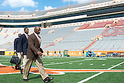 AUSTIN, TX - AUGUST 30:  Texas Longhorns head coach Charlie Strong leads his team across the field before kickoff against the North Texas Mean Green on August 30, 2014 at Darrell K Royal-Texas Memorial Stadium in Austin, Texas.  (Photo by Cooper Neill/Getty Images) *** Local Caption *** Charlie Strong