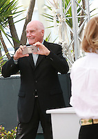 Director Barbet Schroeder taking a photograph at the Amnesia film photo call at the 68th Cannes Film Festival Tuesday May 19th 2015, Cannes, France.