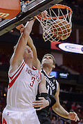 Nov 29, 2013; Houston, TX, USA; Houston Rockets center Omer Asik (3) dunks over Brooklyn Nets center Brook Lopez (11) during the second quarter at Toyota Center. Mandatory Credit: Thomas Campbell-USA TODAY Sports
