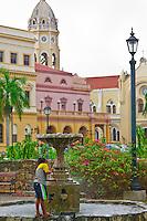 A young boy plays in a fountain at Baluarte de la Monjas (a small square), Casco Viejo (the Old City), San Felipe, Panama City, Panama