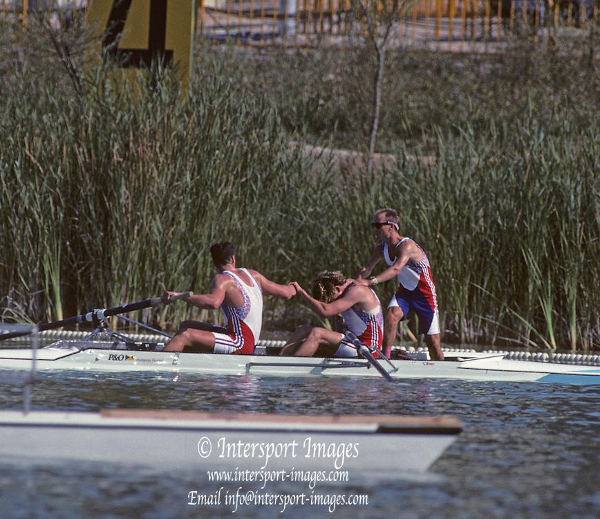 Barcelona, SPAIN. Gold Medalist, GBR M2+, Bow Jonny SEARLE and Greg SEARLE with cox, Gary HERBERT. celebrate after winning the final,. 1992 Olympic Rowing Regatta Lake Banyoles, Catalonia [Mandatory Credit Peter Spurrier/ Intersport Images] Last time Men's coxed pair raced at the Olympics