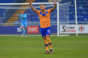 Kellan Gordon of Mansfield Town (12) reacts during the The FA Cup match between Mansfield Town and Dagenham and Redbridge at the One Call Stadium, Mansfield, England on 29 November 2020.