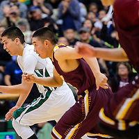 030215       Cable Hoover<br /> <br /> Newcomb Skyhawk Toby Baloo (21) races Tohatchi Cougar Lane Begay (22) down the court during the district championship Monday at Newcomb High School.