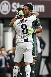 May 19, 2018 - Turin, Italy - Juventus goalkeeper Gianluigi Buffon (1) greets Juventus midfielder Claudio Marchisio (8) during his last football match JUVENTUS - VERONA on 19/05/2018 at the Allianz Stadium in Turin, Italy. (Credit Image: © Matteo Bottanelli/NurPhoto via ZUMA Press)