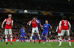 Mesut Ozil of Arsenal and Andreas Bouhalakis of Olympiacos go up for a header - Mandatory by-line: Arron Gent/JMP - 27/02/2020 - FOOTBALL - Emirates Stadium - London, England - Arsenal v Olympiacos - UEFA Europa League Round of 32 second leg