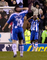 Photo: Jed Wee.<br /> Wigan Athletic v Manchester United. The Barclays Premiership. 06/03/2006.<br /> <br /> Wigan's Henri Camara (R) has his head in his hands as despite having the better chances in the first half, the sides remain deadlocked at 0-0 at half time.