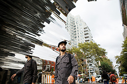 A man pass by the Chinese activist and artist, Ai Weiwei's art project at Washington Square in New York,NY on October 12, 2017.   The artist assembeled 300 establishment around New York City statement  'Good Fences Make Good Neighbors'.  The works can be viewed through February 11, 2018. (Amir Levy/ SIPA USA)