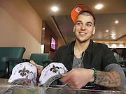 Rob Kardashian signs Super Bowl XLIV hats after the New Orleans Saints defeated the Colts to win the Super Bowl in Miami. Photo ©Suzi Altman
